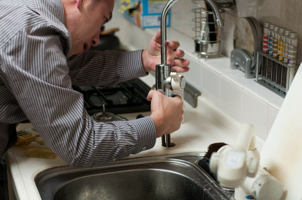 A plumber fixing a sink